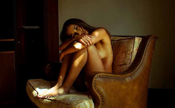 escort sitting on a nice couch